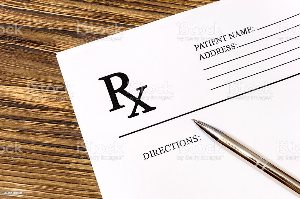 prescription form with pen stock photo
