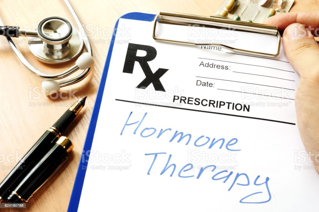 Prescription form with sign hormone therapy. stock photo
