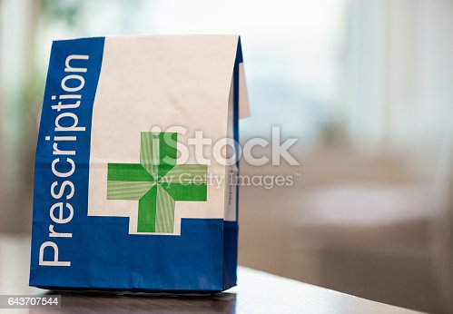 A close-up image of a paper bag containing prescribed medical items.