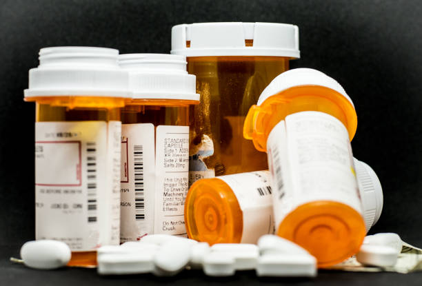 prescription pills and containers - prescription medicine stock pictures, royalty-free photos & images