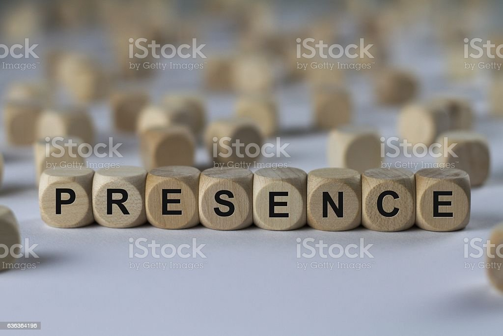 presence - cube with letters, sign with wooden cubes stock photo
