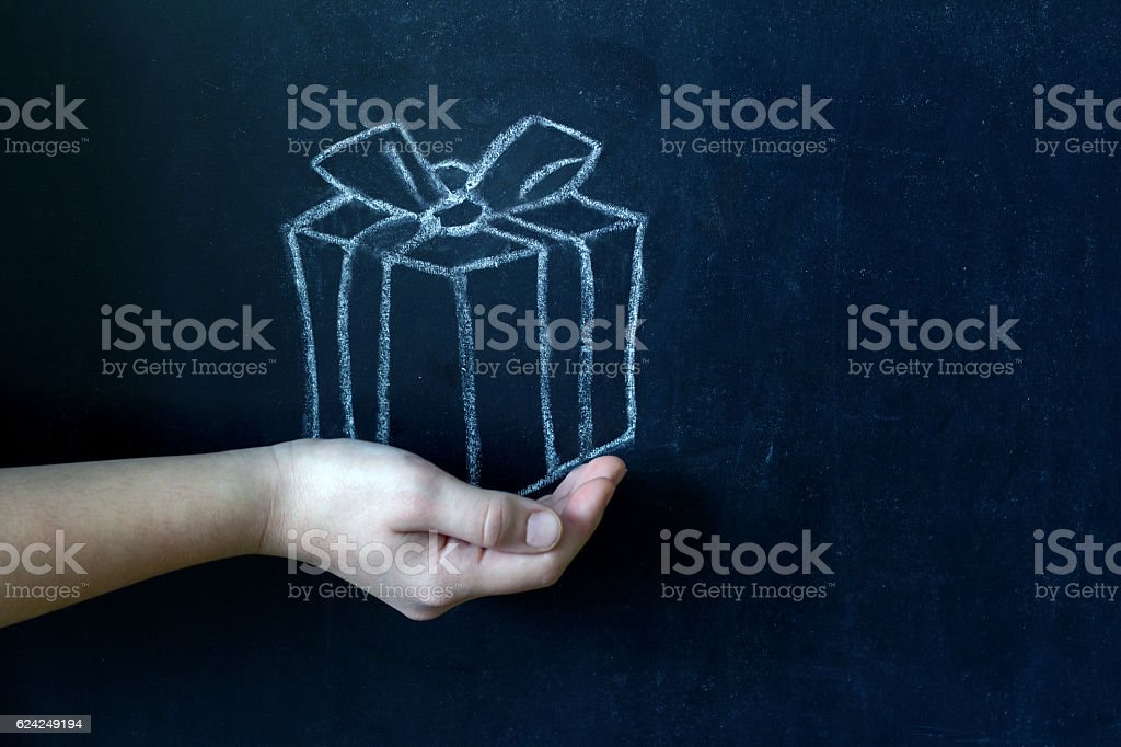 Present and child's hand abstract background stock photo