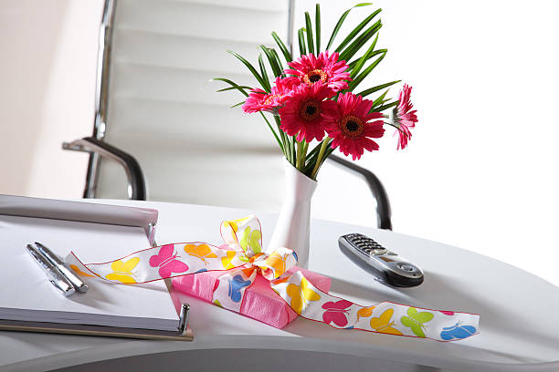 Royalty Free Telephone And Flower Vase On Office Desk Pictures