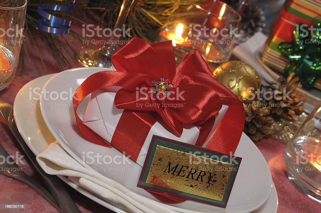 Present at the festive table for Christmas royalty-free stock photo