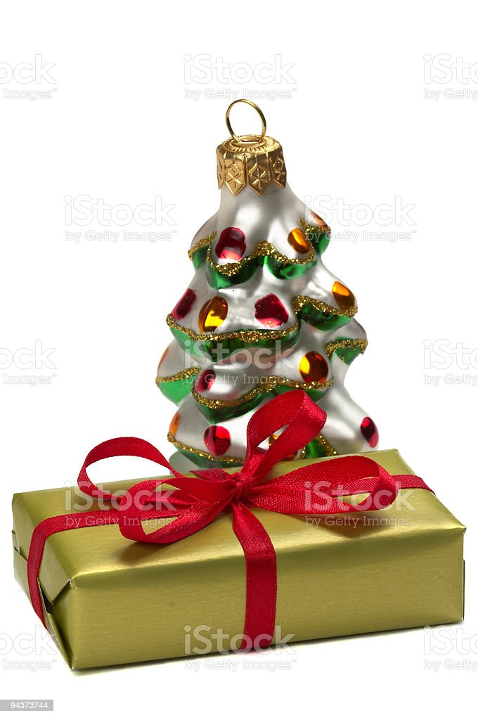 Present box and a Happy New Year tree decoration toy royalty-free stock photo