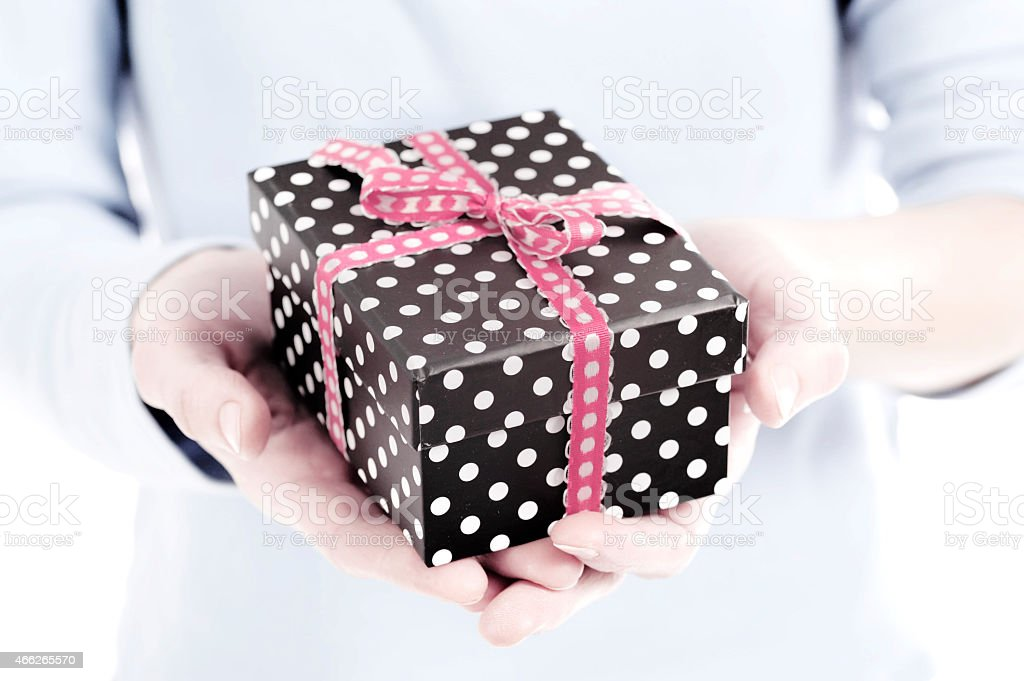 present box in a woman hand close up stock photo