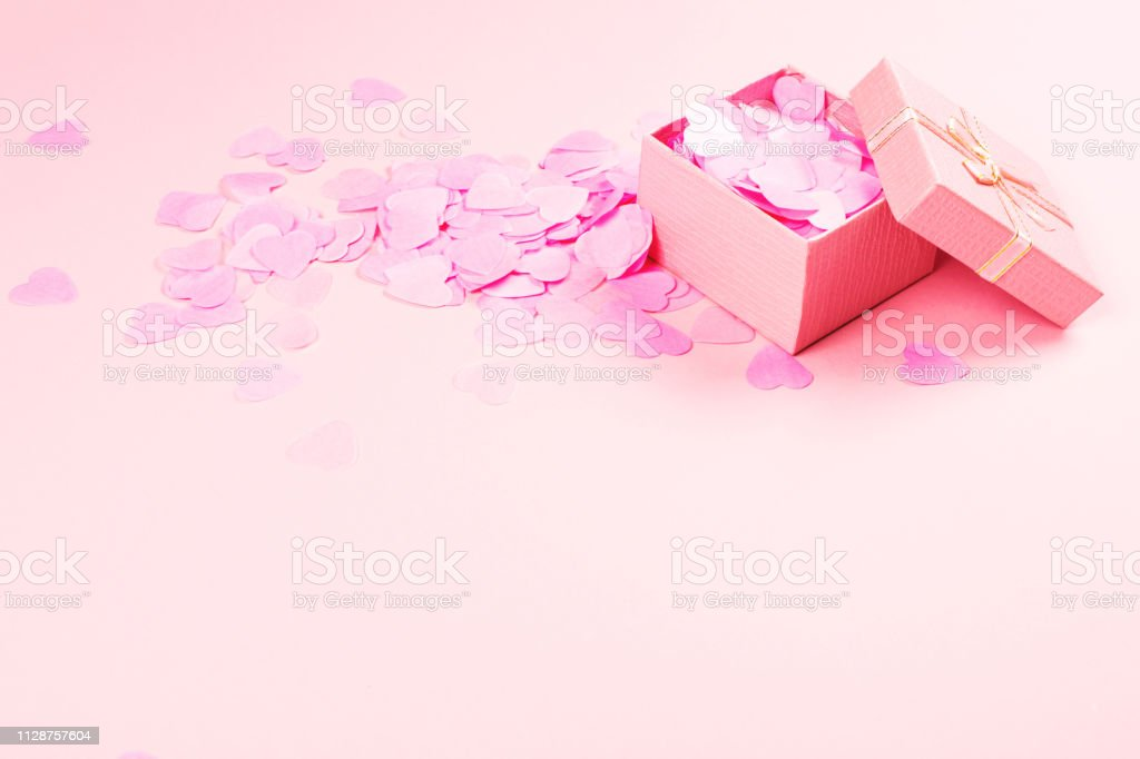 Little cute open present box with shiny satin bow full of...