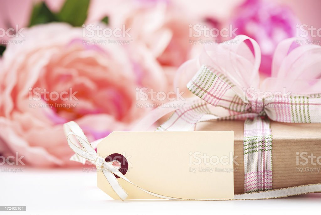 Present box on pink with an empty label royalty-free stock photo