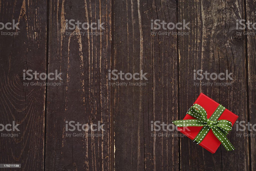 Present box on wooden background royalty-free stock photo