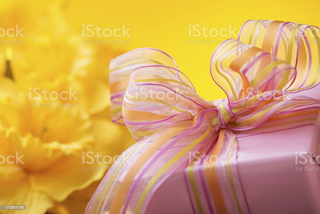 Present box on yellow royalty-free stock photo
