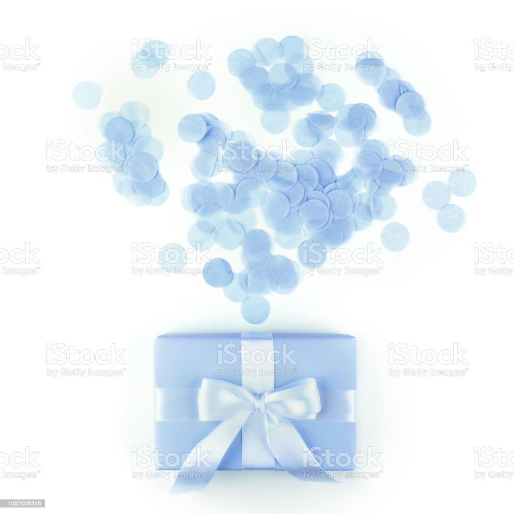 Present box with blue, bow on white background. stock photo