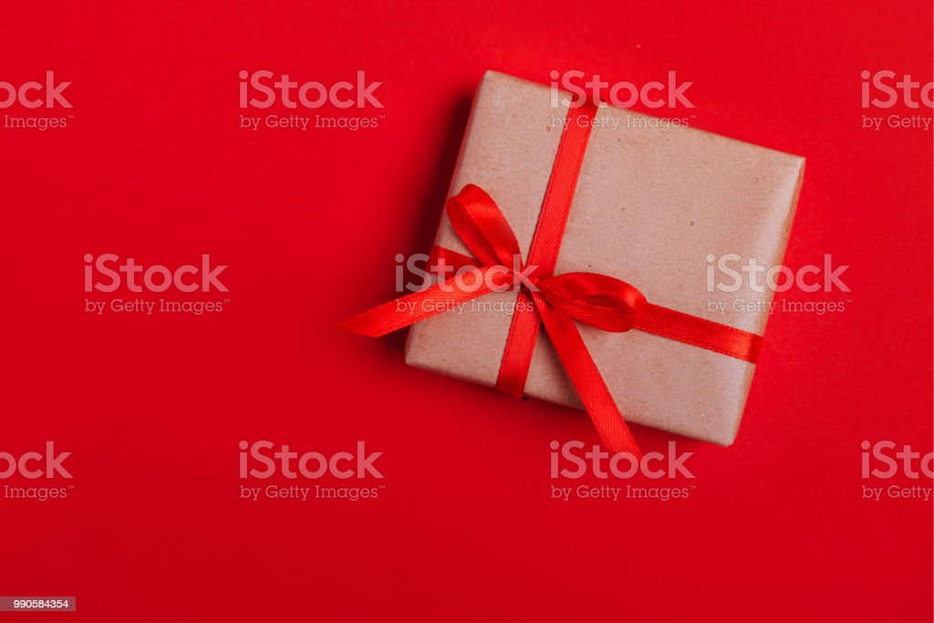 Present box with red bow on colorful background stock photo