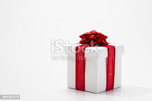 istock Present box with ribbon bow 884362476
