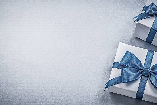 present boxes on blue background greeting card holidays concept - birthday gift stock photos and pictures