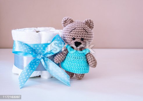 875685464 istock photo Present cake with diapers for newborn baby boy with little teddy 1172163097