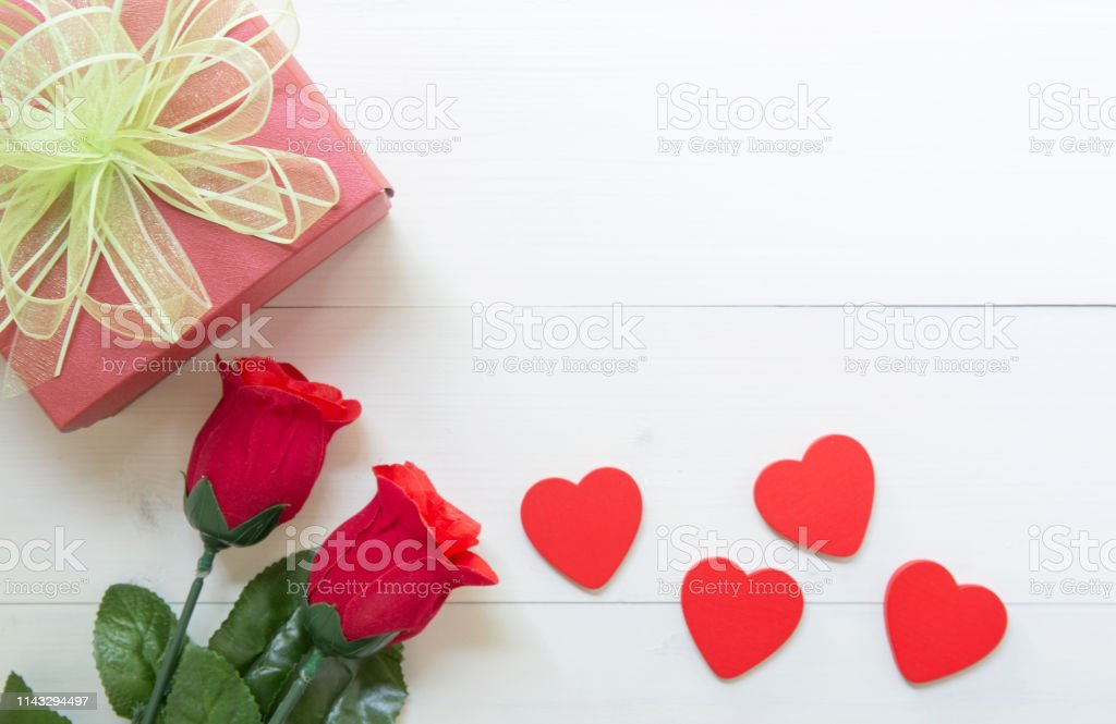 Present gift with red rose flower and gift box with bow ribbon and...