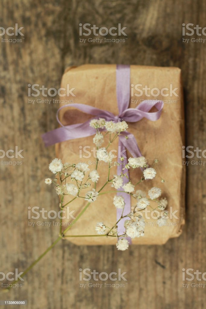present handmade cosmetics wrapped in papper and flowers