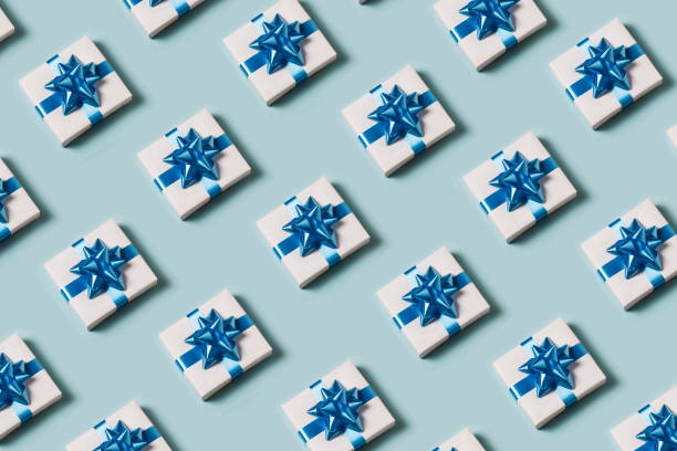 Present on blue background Present on blue background gift box stock pictures, royalty-free photos & images
