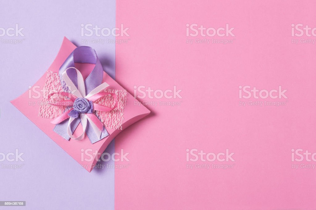 Present on pink and purple background