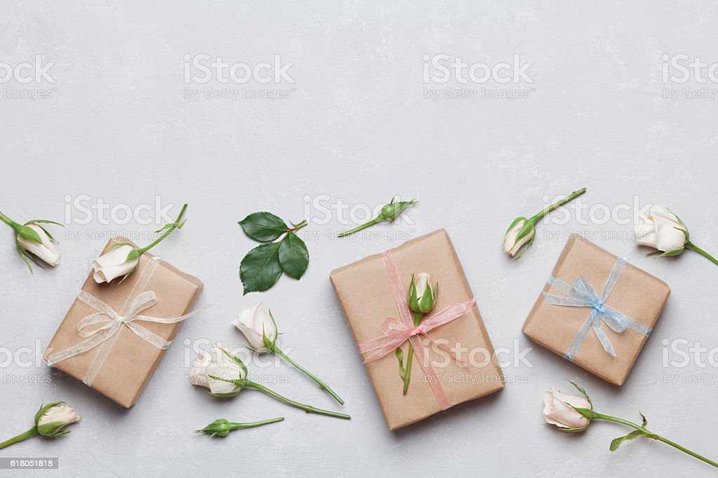 Present or gift decorated rose flowers. Holiday concept. Flat lay. stock photo
