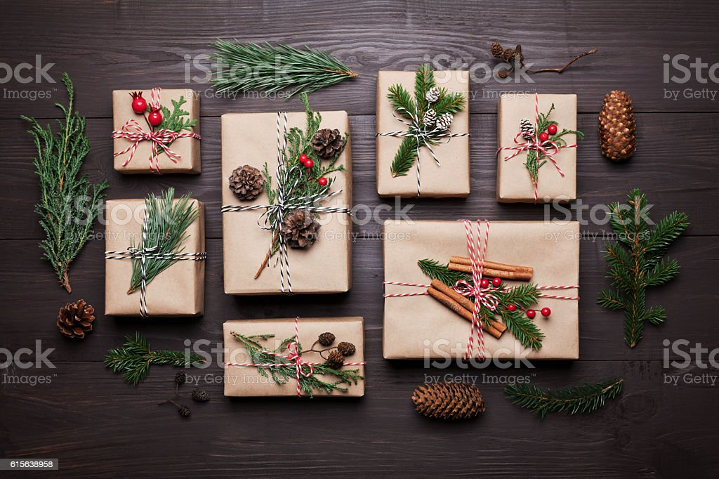 Present or gift with christmas decoration and fir. Flat lay. stock photo