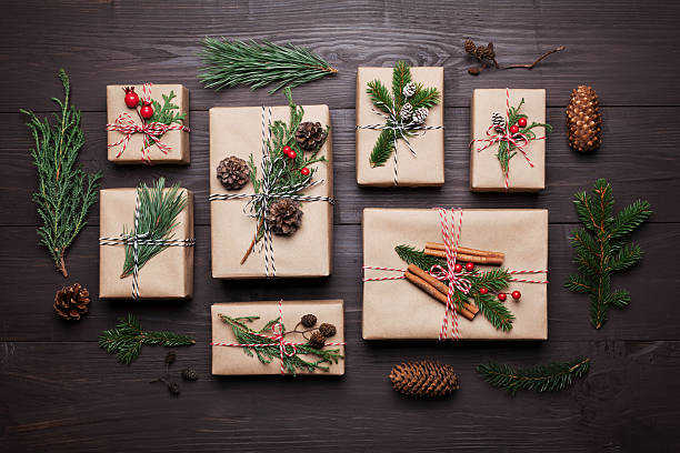 present or gift with christmas decoration and fir. flat lay. - papier weihnachtsschmuck stock-fotos und bilder