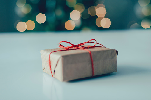 Present Wrapped In Brown Paper Stock Photo - Download Image Now