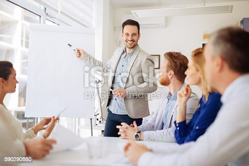 istock Presentation and collaboration by business people 590290880