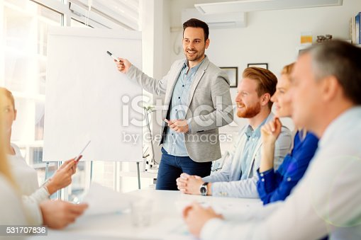 1028234706 istock photo Presentation and training in business office 531707836