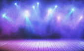 Wooden stage with blue smoke and spot lights. Presentation concept