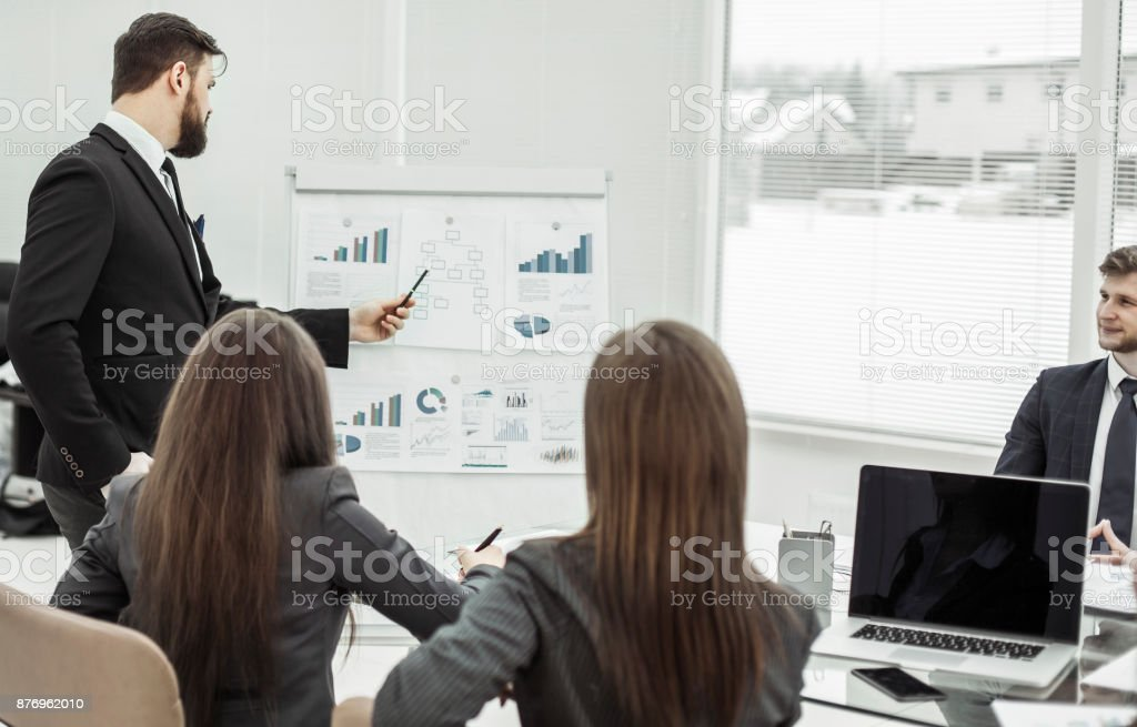 presentation of a new financial project on a workplace at office stock photo