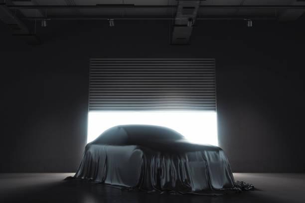 presentation of the car covered with black cloth. 3d rendering - coprire foto e immagini stock