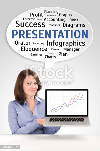 Presentation of a young business woman who is showing charts on a laptop screen, business concept