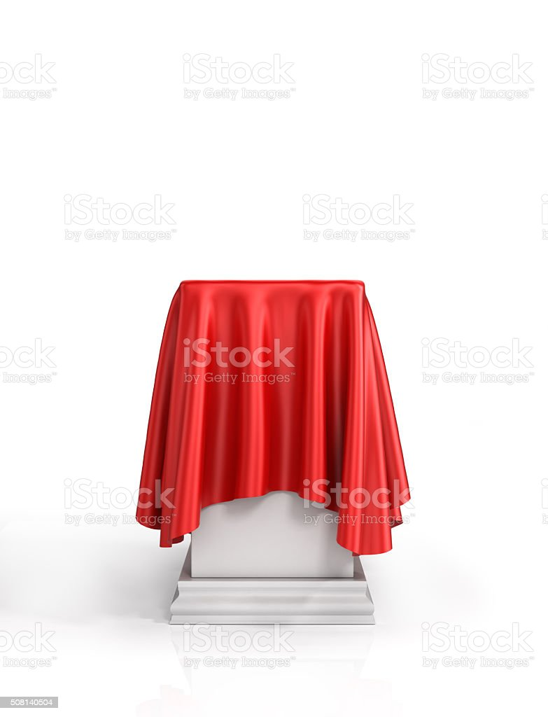 Presentation pedestal covered with a red silk cloth stock photo