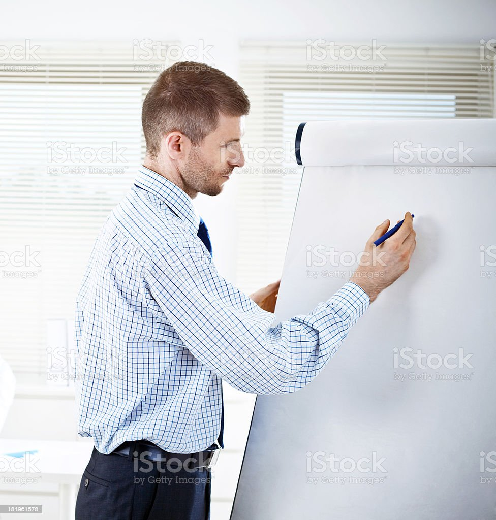 Presentation Businessman during a meeting, giving presentation on white board. 30-34 Years Stock Photo