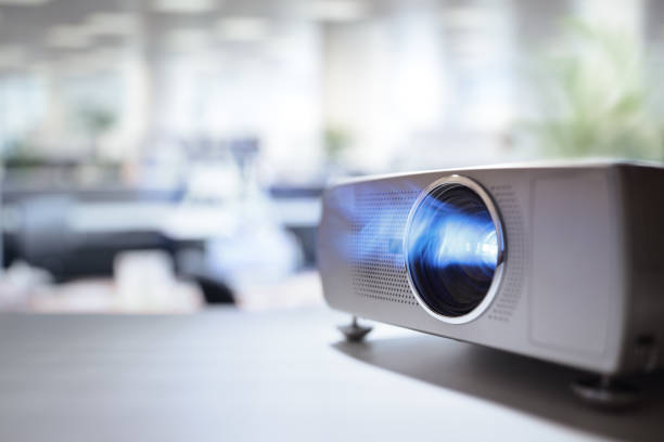 Presentation with lcd video projector in office LCD video projector at business conference or lecture in office with copy space overhead projector stock pictures, royalty-free photos & images