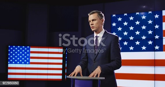 istock Presenter in front of American flag 922950050