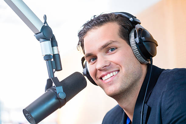 presenter in radio station on air - radio dj stock photos and pictures