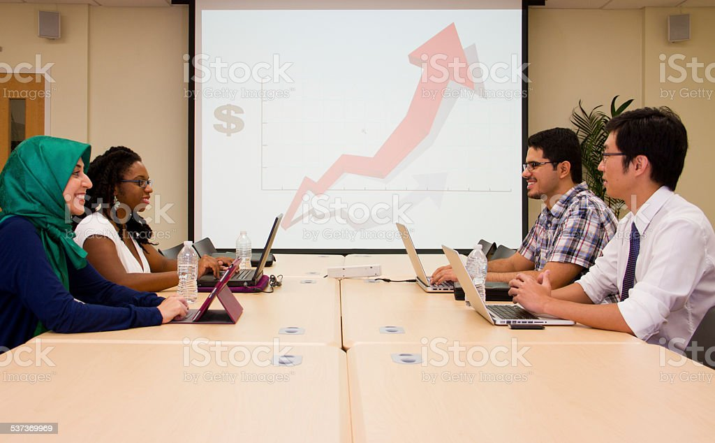 Presenter is presenting & students are working Classroom international style stock photo