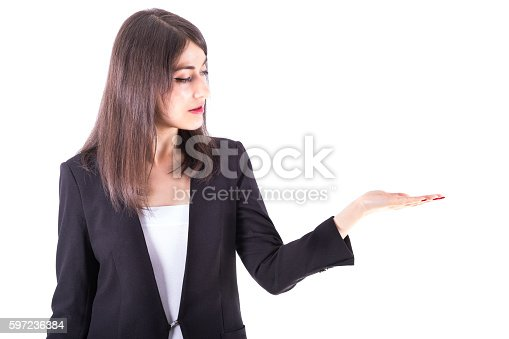 Image of a young woman introducing something in her hand