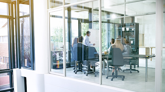 Shot of a businessman giving a presentation to his colleagues in an office