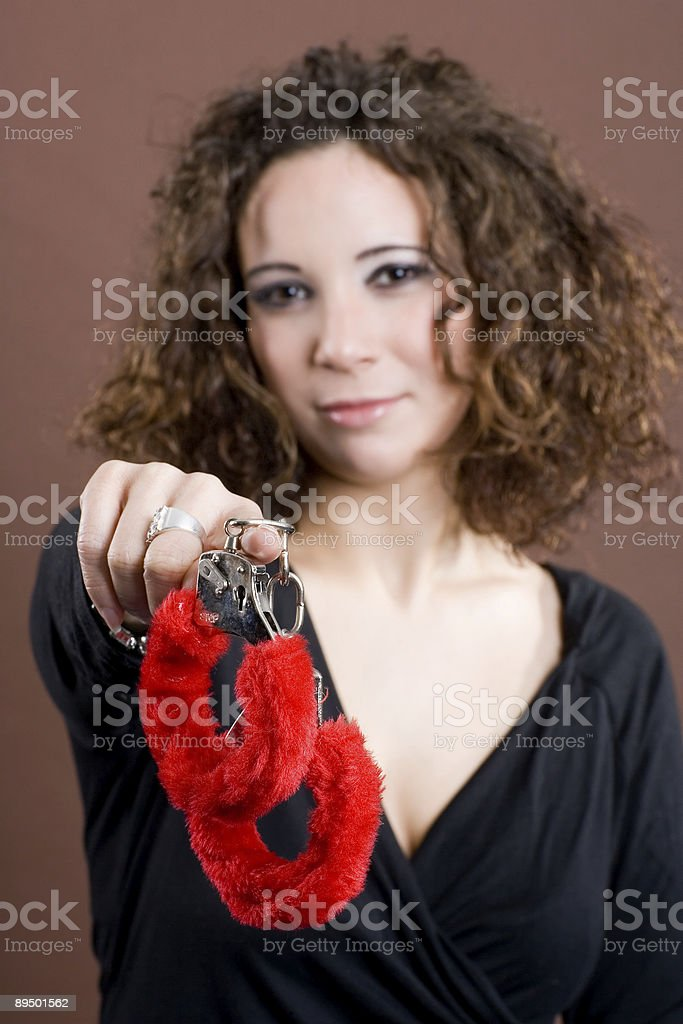 Presenting fluffy red handcuffs royalty-free stock photo