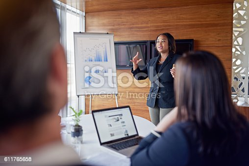 Shot of a businesswoman giving a presentation in the boardroom