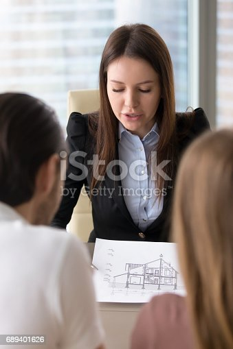 istock Presenting house plan, building project on meeting with clients indoors 689401626