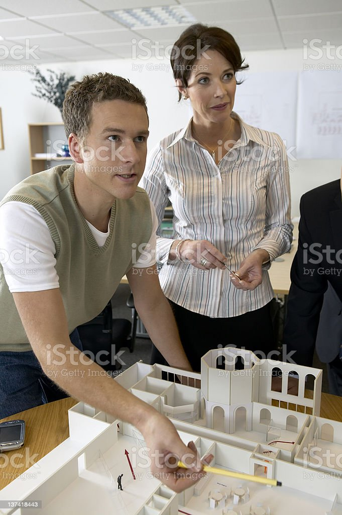 Presenting to the client .N.B.* Mocked up models and plans royalty-free stock photo
