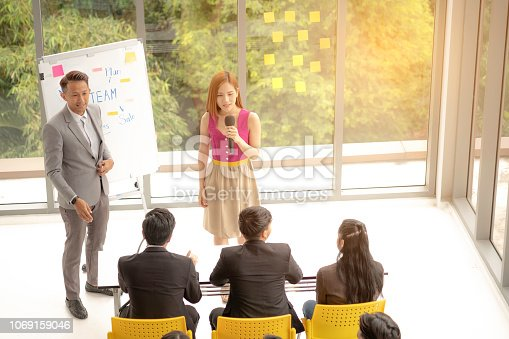 1031235468 istock photo Presenting works in modern office. 1069159046