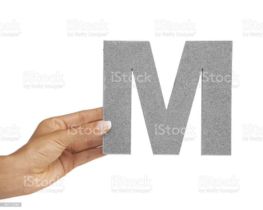 Presenting you the letter 'M' royalty-free stock photo