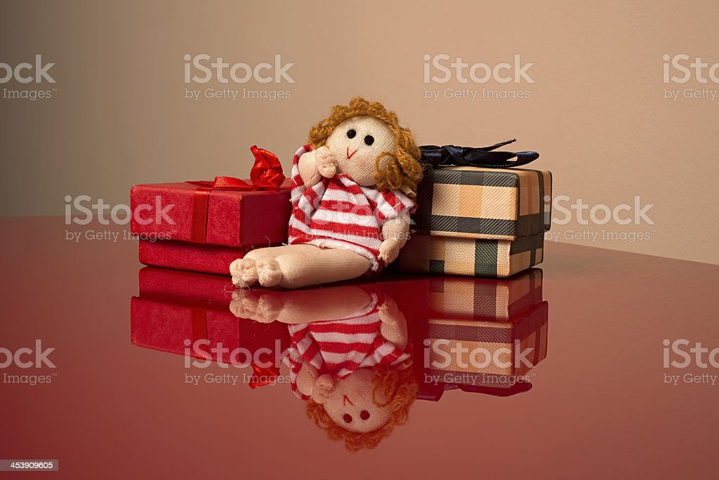 Presents and doll stock photo