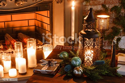 istock Presents and Gift boxes under Christmas Tree. Colorful boxes with ribbon bow. New year decorated house interior. Winter Holiday concept. 1076192222