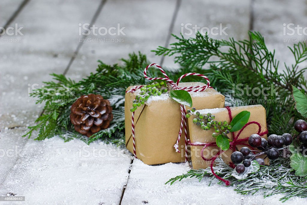 Presents and green garland on winter background stock photo